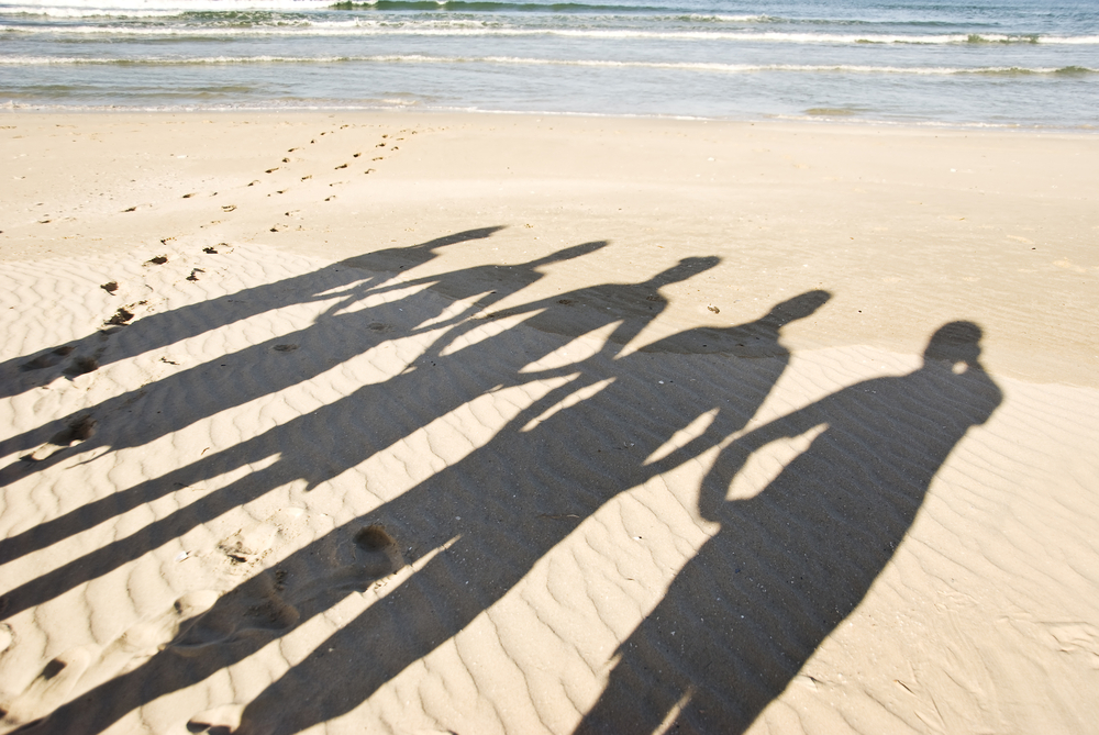 Shadows on the beach - Isle of Man Community Care